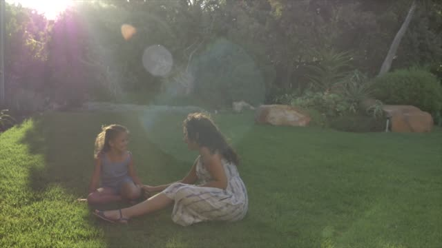 mother and daughter blowing kisses in yard - sonnig stock-videos und b-roll-filmmaterial