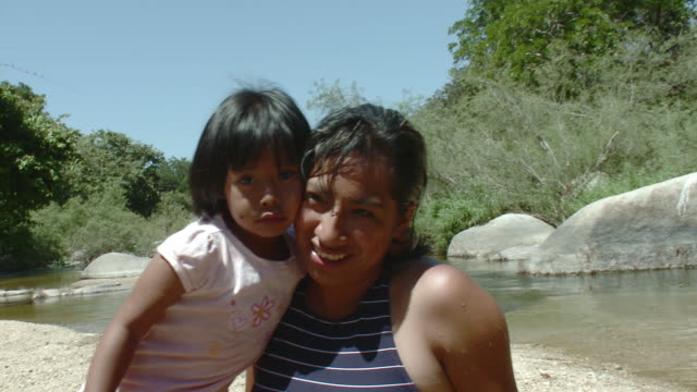 MS PAN Mother and daughter (4-5) by river / Yelapa, Jalisco, Mexico