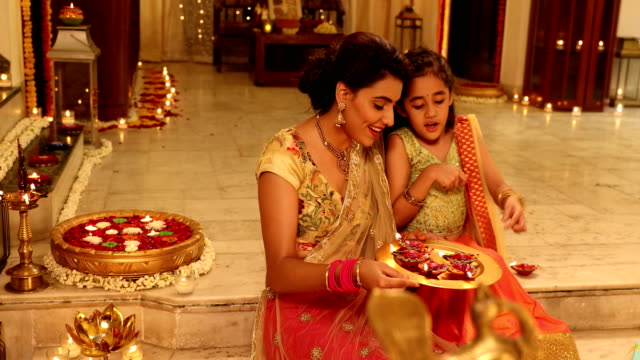 mother and daughter celebrating diwali festival, delhi, india - beautiful people stock videos & royalty-free footage
