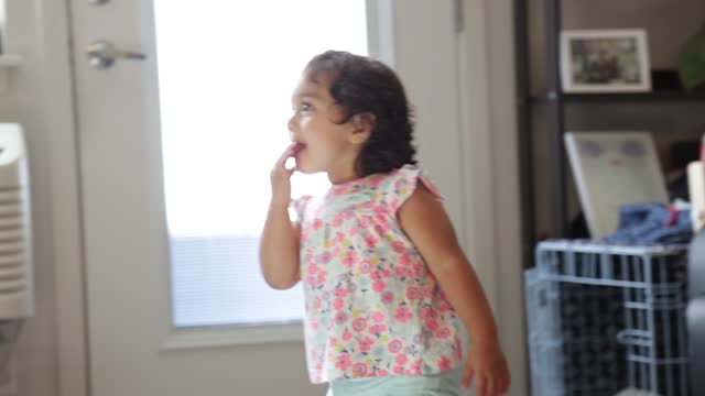 mother and daughter cheerfully give a high five to each other - one parent stock videos & royalty-free footage