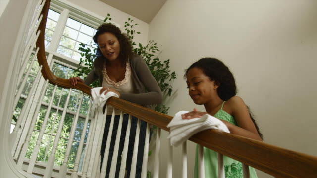 la ws mother and daughter (12-13) cleaning balustrade / edmonds, washington state, usa - pacific islander family stock videos & royalty-free footage
