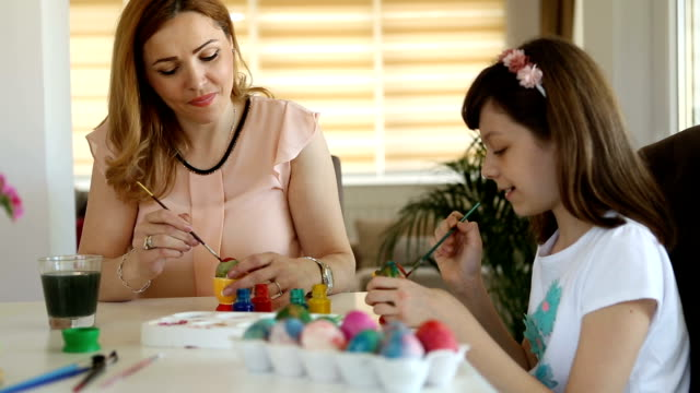 mother and daughter coloring easter eggs at home - easter stock videos & royalty-free footage