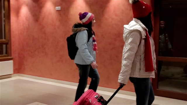 Mother and daughter come to the hotel,winter vacation