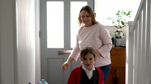 mother and daughter coming home from school - waist up stock videos & royalty-free footage