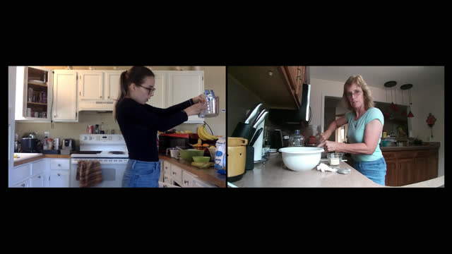 vídeos de stock e filmes b-roll de a mother and daughter cook together via video call in their separate homes - vida real