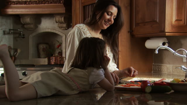 mother and daughter cooking in kitchen - see other clips from this shoot 1167 stock videos and b-roll footage