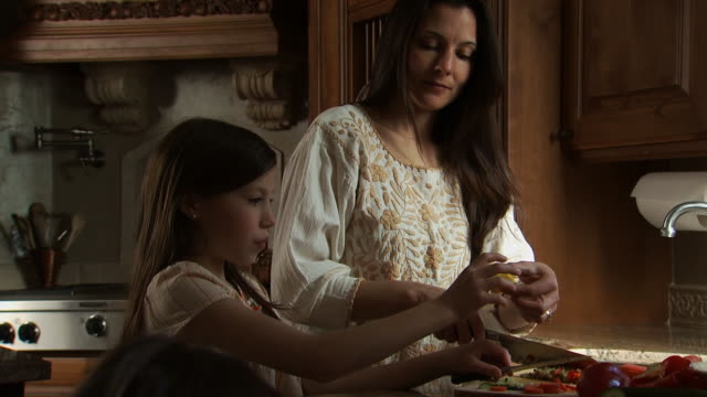 mother and daughter cooking in kitchen - daughter stock videos & royalty-free footage