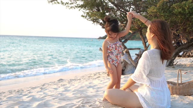 mother and daughter dancing on the beach - back lit stock videos & royalty-free footage