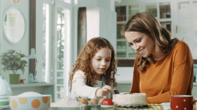 mother and daughter decorating cake together - decoration stock videos & royalty-free footage