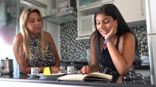 mother and daughter discussing ideas in the kitchen - budget stock videos & royalty-free footage