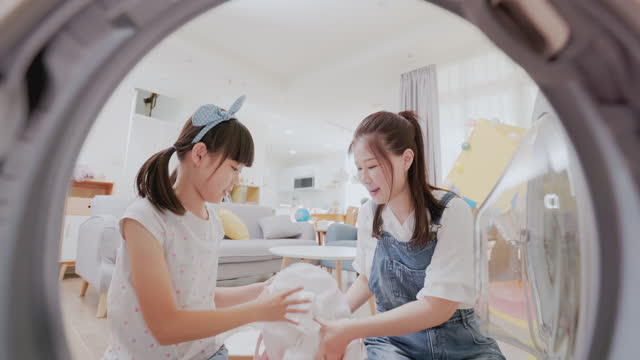 mother and daughter do laundry - hamper stock videos & royalty-free footage
