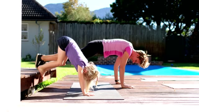 mother and daughter doing fun home fitness - enjoyment stock videos & royalty-free footage