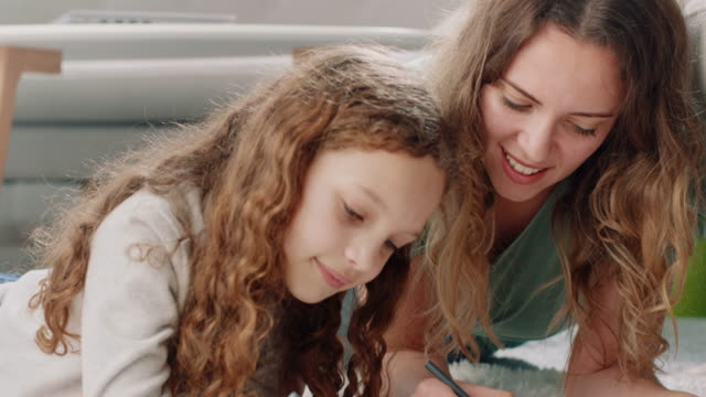 mother and daughter doing homework together - crayon stock videos & royalty-free footage