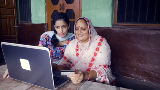 mother and daughter doing online shopping at home. - credit card stock videos and b-roll footage