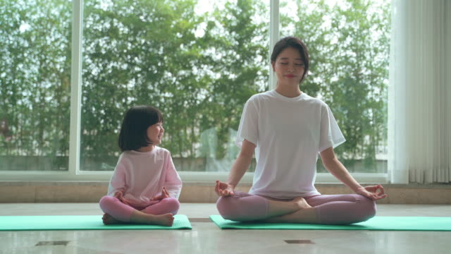 mother and daughter doing yoga at home - daughter stock videos & royalty-free footage