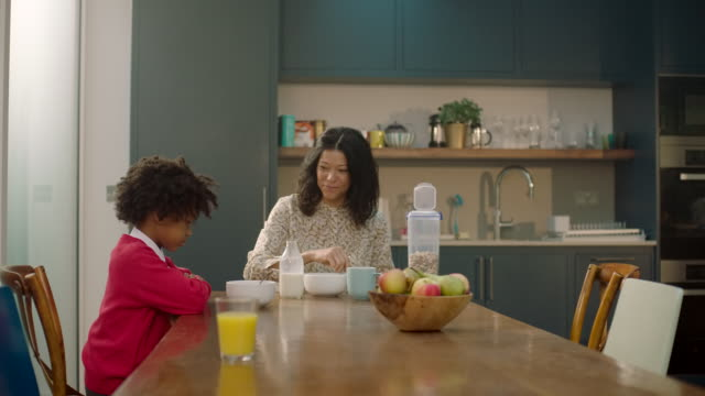 a mother and daughter eating breakfast together. - domestic kitchen stock videos & royalty-free footage