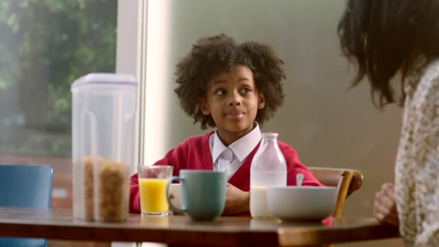 a mother and daughter eating breakfast together. - child stock videos & royalty-free footage