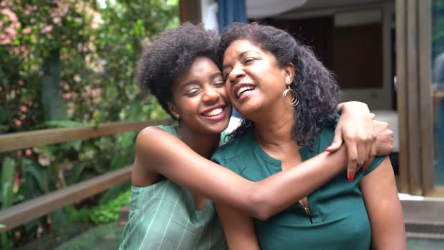 mother and daughter embracing at home - love emotion stock videos & royalty-free footage