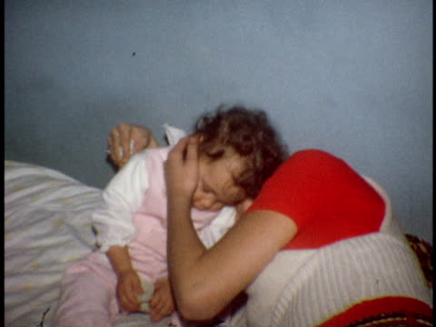 1972 ms mother and daughter embracing on bed / bronx, new york - 1972 stock videos and b-roll footage