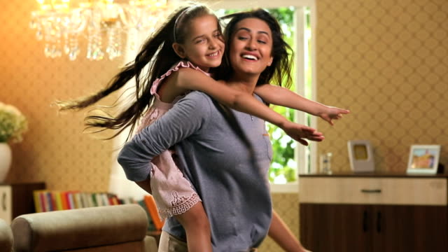 mother and daughter enjoying at home, delhi, india - piggyback stock videos and b-roll footage