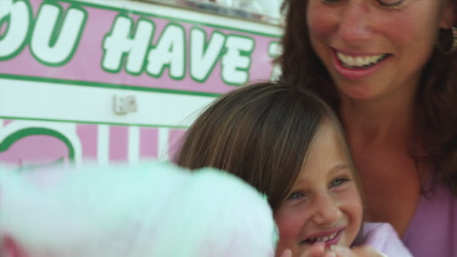 cu td mother and daughter (4-5) enjoying cotton candy at state fair / rutland, vermont, usa - vermont stock videos & royalty-free footage