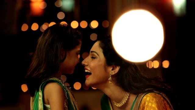 ms pan mother and daughter enjoying diwali festival - 焦点点の映像素材/bロール