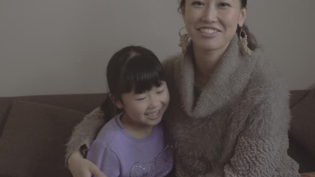 mother and daughter enjoying in the room - daughter点の映像素材/bロール