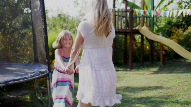 mother and daughter enjoying outdoors. - domestic garden stock videos and b-roll footage