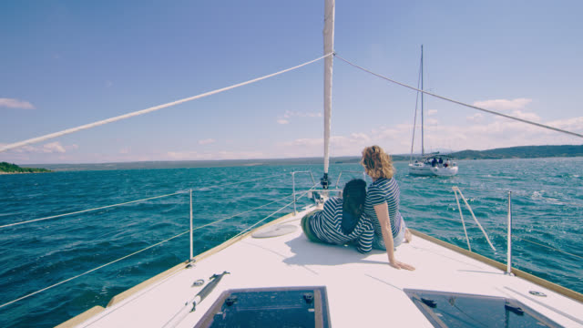 ws mother and daughter enjoying the view while sailing in the bay - sitting stock videos & royalty-free footage