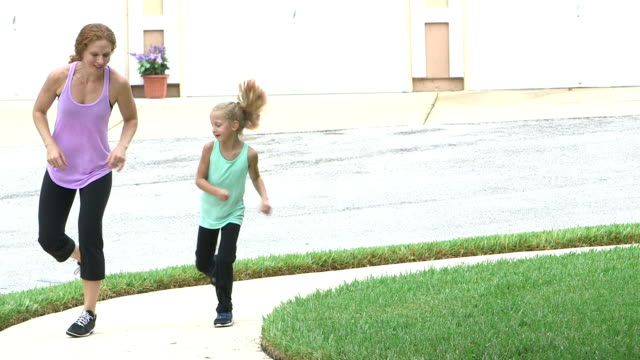 mother and daughter exercising, playing outdoors - copying stock videos & royalty-free footage