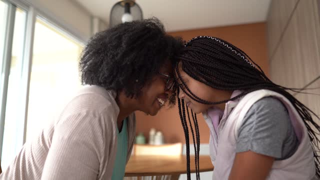 mother and daughter face to face on affection moment at home - natural black hair stock videos & royalty-free footage