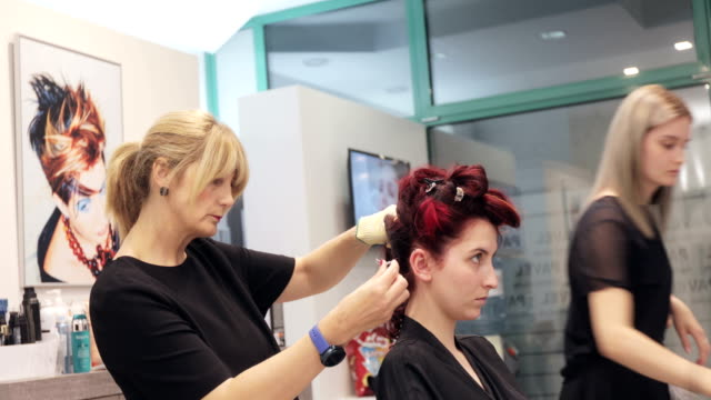 mother and daughter hairdressers working in their hair salon - hairdresser stock videos & royalty-free footage