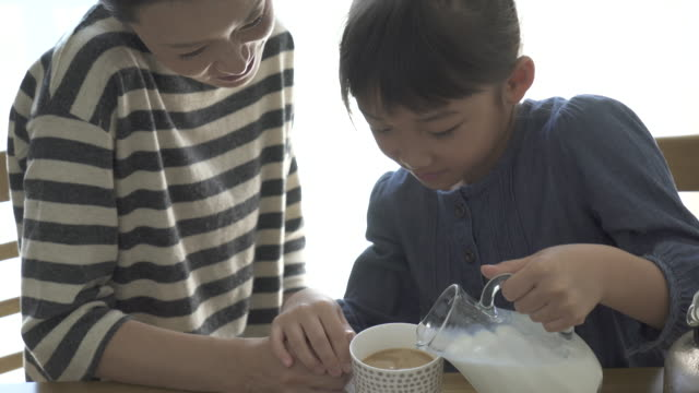 mother and daughter have a coffee break in the room - pre adolescent child stock videos and b-roll footage
