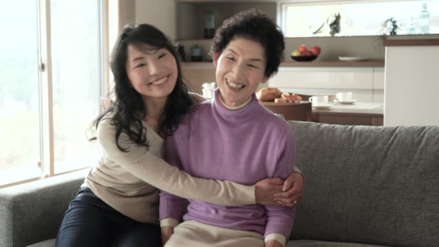 mother and daughter have a happy moment together at home - japanese mom stock videos & royalty-free footage