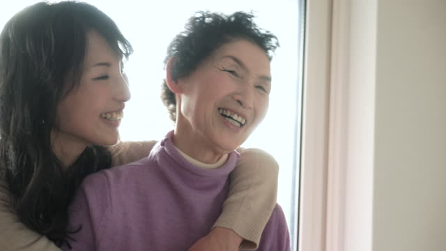 Mother and daughter have a happy moment together at home