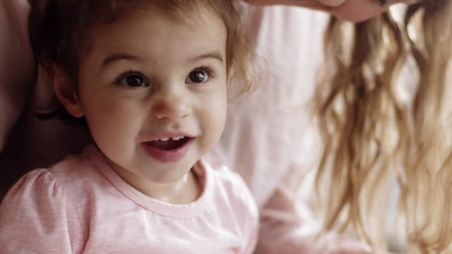 mother and daughter having fun at living room - baby girls stock videos & royalty-free footage