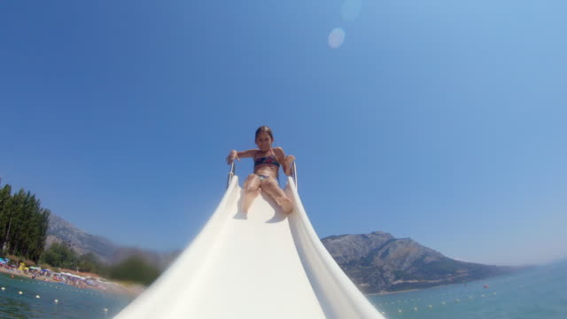 mother and daughter having fun on pedal boat slide - pedal boat stock videos and b-roll footage