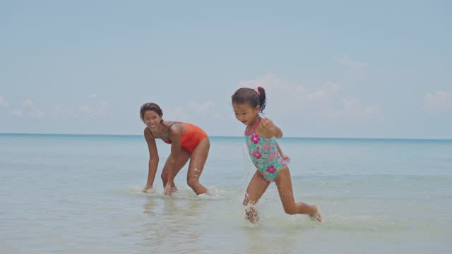 mother and daughter having fun on the beach - beach holiday stock videos & royalty-free footage