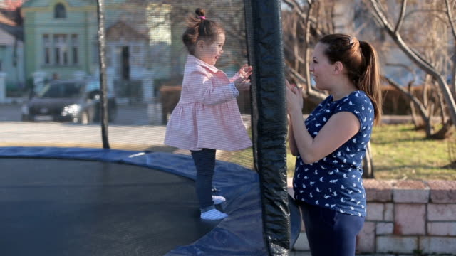 mother and daughter having fun outside in a park - parent stock videos & royalty-free footage