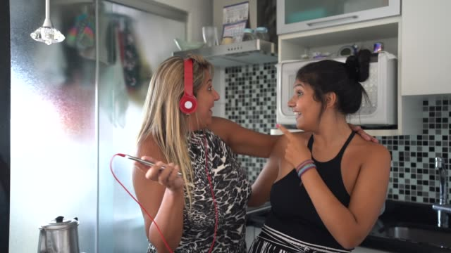 mother and daughter having fun together while dancing in the kitchen - 18 teen stock videos & royalty-free footage