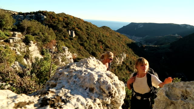 mother and daughter hiking in mediterranean hills - 20 24 years stock videos & royalty-free footage