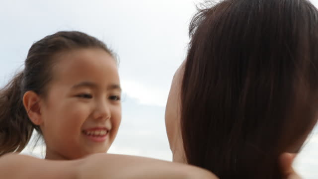 c/u mother and daughter hugging , daughter looks to camera over mother's shoulders - 6 7 years stock videos & royalty-free footage