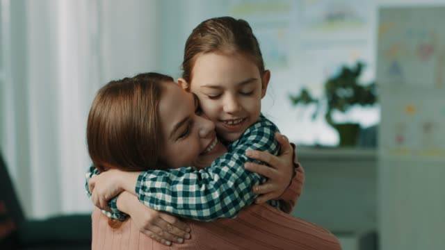 mother and daughter hugging - close to stock videos & royalty-free footage