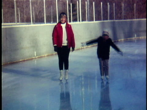 1968 WS Mother and daughter (6-7) ice skating, Middlebury, Vermont, USA