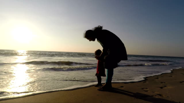 mother and daughter in beach