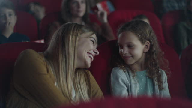 mother and daughter in cinema - film screening stock videos & royalty-free footage
