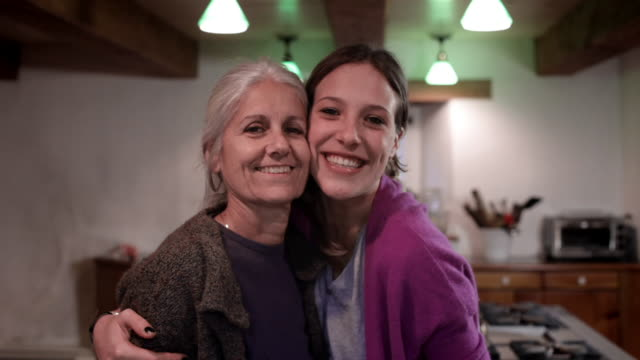 ms mother and daughter in kitchen / kingston, new york, usa  - solo donne video stock e b–roll
