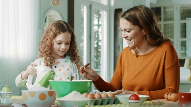 mother and daughter in kitchen - baking stock videos & royalty-free footage