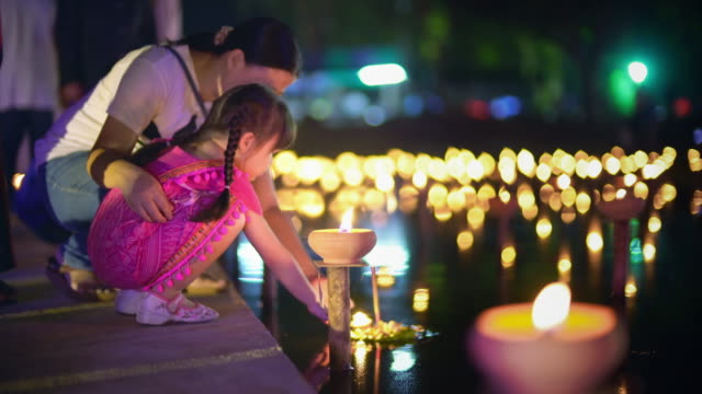 mother and daughter in loi krathong traditional festival - thailand stock videos & royalty-free footage