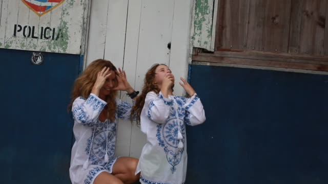 mother and daughter in matching outfits satirical modelling shoot as they point and pose. - matching outfits stock videos & royalty-free footage